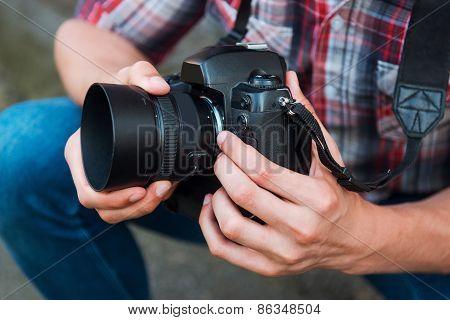 Examining Camera Before Shooting.
