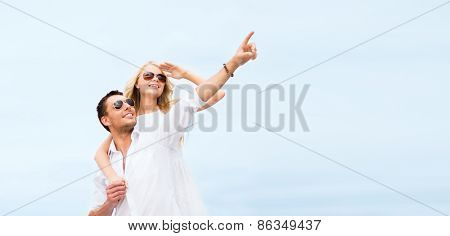 summer holidays and dating concept - couple in shades at sea side
