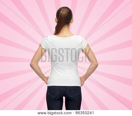 t-shirt design, advertisement and people concept - woman in blank white t-shirt over pink burst rays background from back