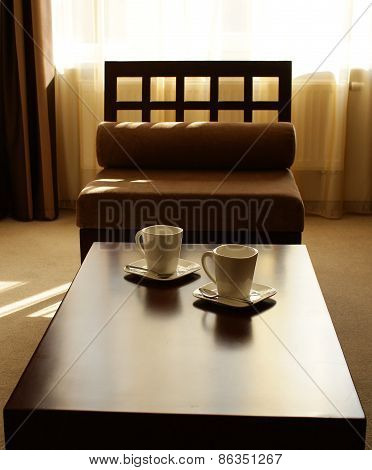 Tea cups. Set for two persons, served in japan style interior