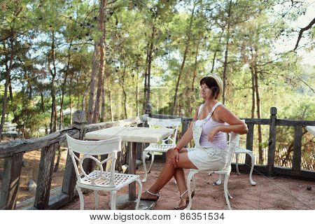 Woman On A Chair At The Table