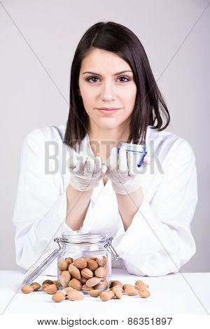 Dermatologist doctor presenting new creme.Organic curative therapeutic medicine cosmetics.