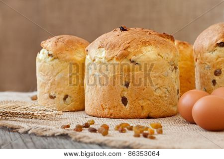 Traditional Italian Panettone Holiday Biscuit Cake With Raisins On Vintage Textile