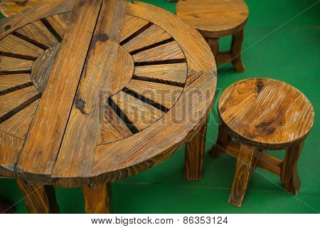Set Of Wooden Table And Chairs On Carpet