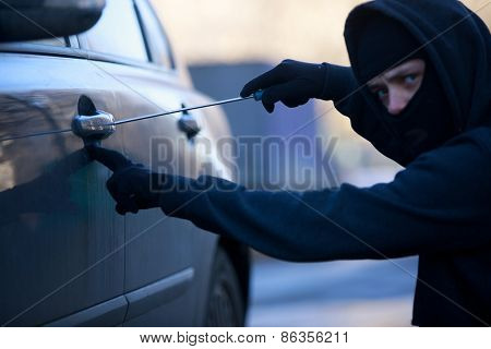 car thief . Focused on screwdriver