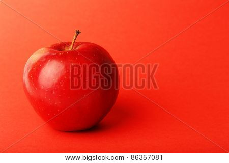 Apple on color background
