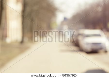 blur background, summer time in town street with parked cars