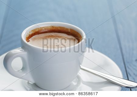 closeup of fresh espresso on light blue wooden table