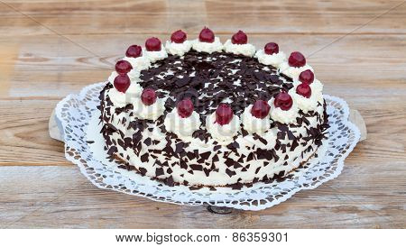 Black Forest Cake On Rustic Wood