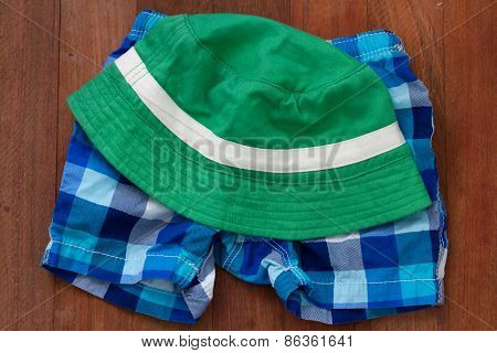 Hat With Shorts On Brown Background