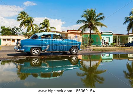 Cienfuegos - February 22: Streets Of Cienfuegos With Classic Old Car And Palm Tree In Background On