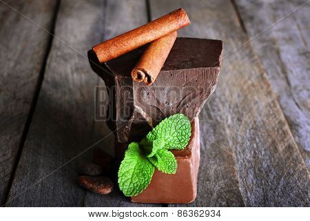 Still life with set of chocolate on wooden background