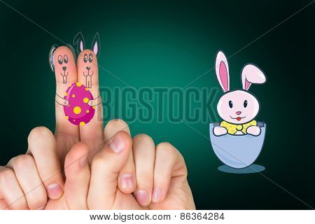 Fingers as easter bunny against green background with vignette