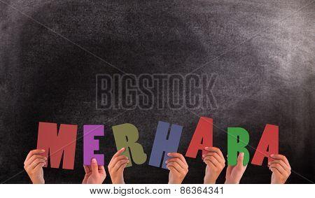 Hands holding up merhaba against black background