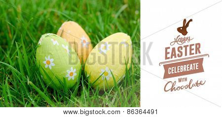 happy easter graphic against three easter eggs in the grass
