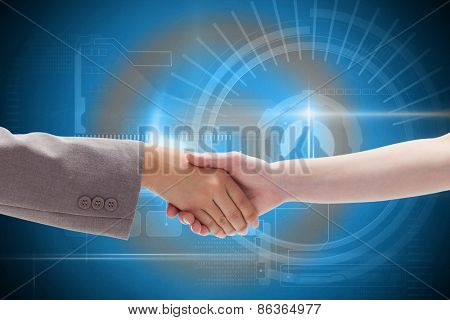Handshake between two women against blue technology interface with dial