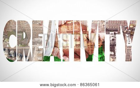 The word creativity and side view of business peoples hands shaking against new york
