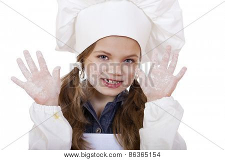 cute little girl baking on kitchen and shows hands isolated on a white background