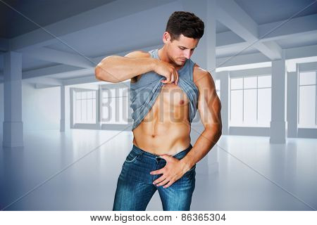 Attractive bodybuilder against white room with windows