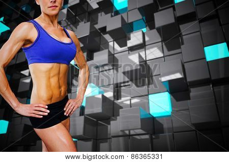 Female bodybuilder against blue and black tile design