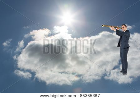 Businessman looking through telescope against blue sky with clouds and sun
