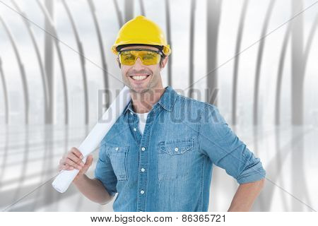 Architect holding rolled blueprint against white room with large window overlooking city
