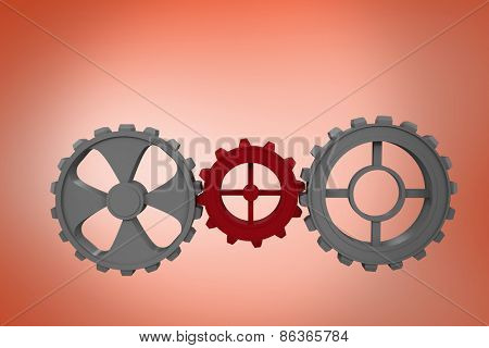Cogs and wheels against orange