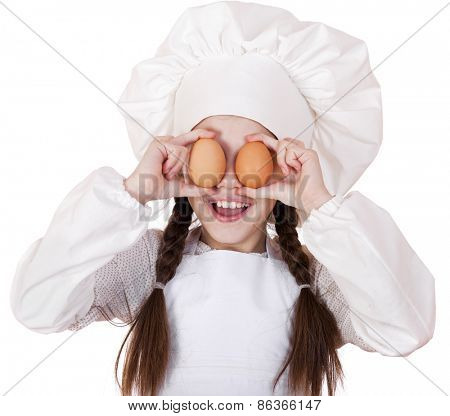 Portrait of a little girl in a white apron holding two chicken eggs, isolated on white background