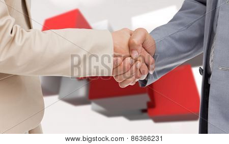 Close up of people shaking hands against red tile pattern