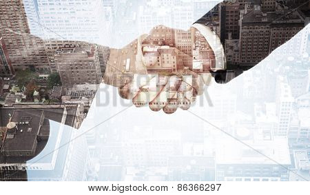 Handshake between two business people against new york