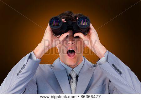 Suprised businessman looking through binoculars against orange background with vignette