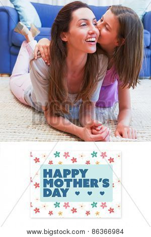 mothers day greeting against mother and daughter on the floor