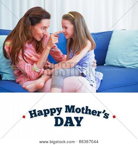 mothers day greeting against mother and daughter on the couch