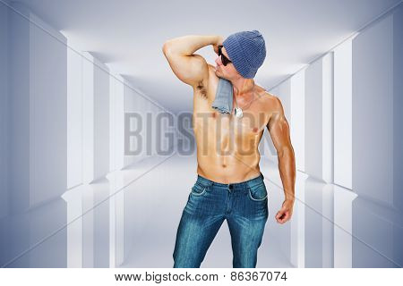 Attractive bodybuilder against digitally generated room