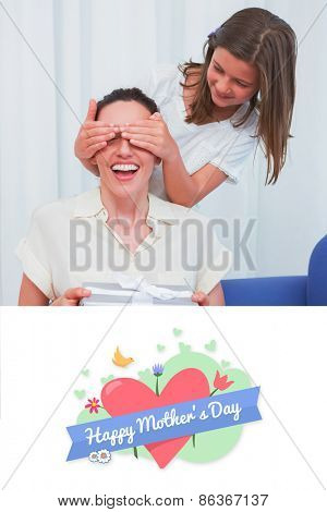 mothers day greeting against daughter giving her mother a present