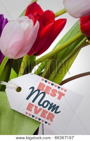 best mom ever against tulips with note