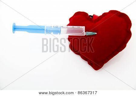 Syringe injecting a red heart and health concept healthy life