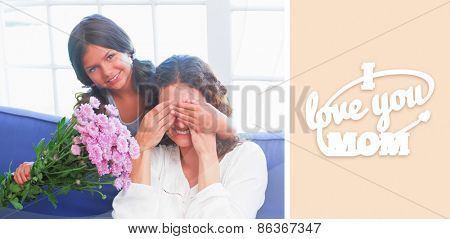 mothers day greeting against smiling girl offering flowers to her mother