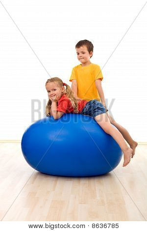 Kids Playing With A Large Exercise Ball