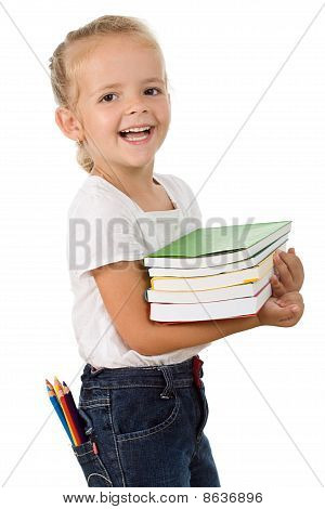 Happy Little Girl With School Books And Colored Pencils
