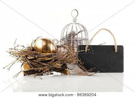 Golden Egg In Nest With Blackboard With Space For Text, On White Background