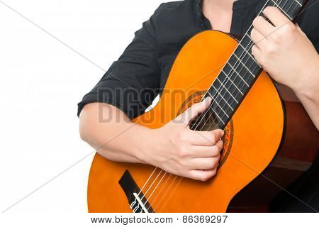 Female hands playing an acoustic guitar isolated on a white background