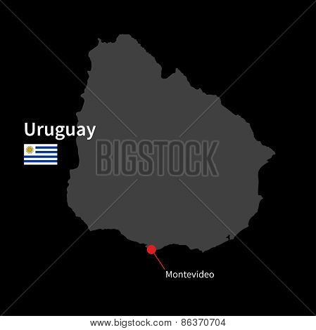 Detailed map of Uruguay and capital city Montevideo with flag on black background