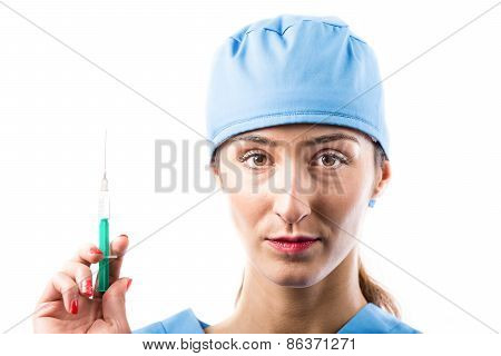 A Nurse With Syringe In Her Hand.