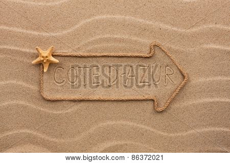 Arrow Made Of Rope And Starfish With The Word Côte D'azur On The Sand