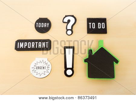 Six Magnets With Different Keywords, Important, To Do, Today And Urgent Sign On Wooden Table