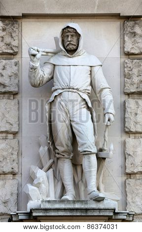 VIENNA, AUSTRIA - OCTOBER 10: Werner David: Miner, on the facade of the Neuen Burg on Heldenplatz in Vienna, Austria on October 10, 2014.