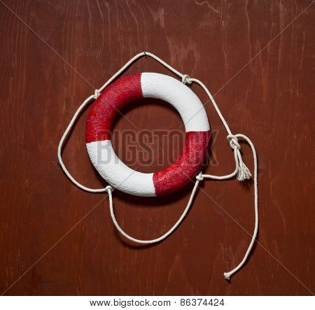 Red and white life buoy