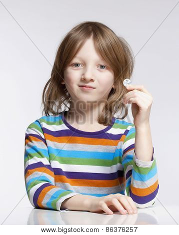 Boy Holding Up A Coin