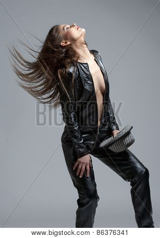 Woman In Leather Dress Holding A Hat